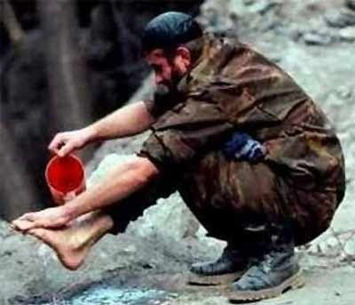 soldier cleaning feet